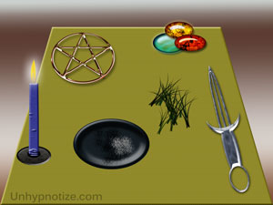 A simple example of the top of an altar and some of the items that would commonly be on it. Pentagram, Athame (ceremonial dagger), plate for burning items, candle, stones, and herbs are depicted here.