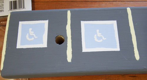 Handicap parking spaces on wall-side railing of loft bed.