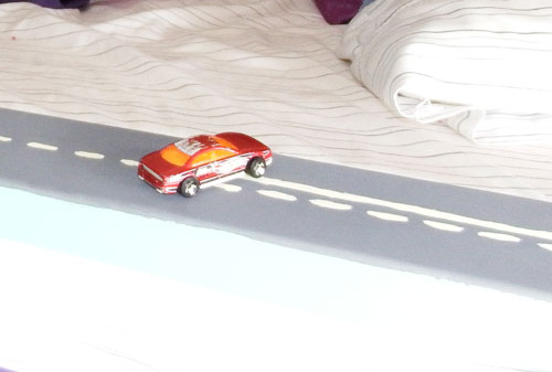 Road railing on bed #1. Lines on road include dotted line, solid and dotted line, and double solid lines, for teaching passing rules on road.
