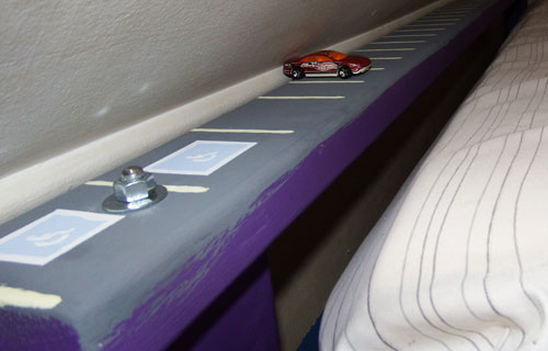 Parking lot railing on bed #1. Equipped with handicapped parking spaces to teach children.